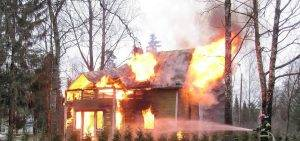 burning house that will benefit from fire damage restoration