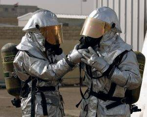 employees in hazmat suits completing a job